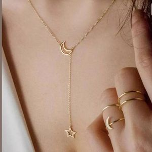 NWT • gold star and moon necklace